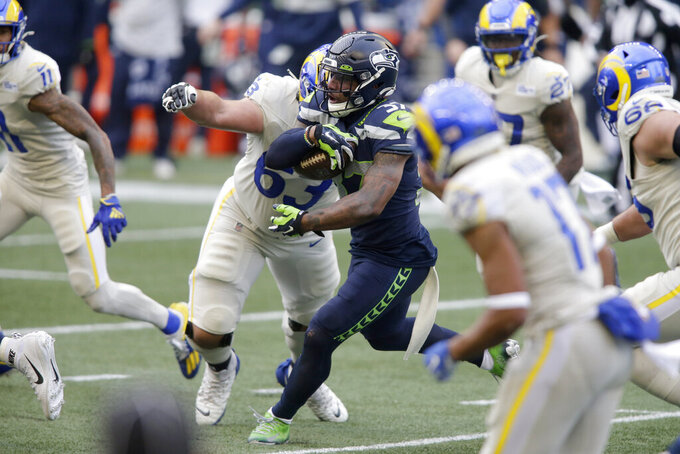 Seattle Seahawks free safety Quandre Diggs (37) runs after intercepting a pass during the first half of an NFL football game against the Los Angeles Rams, Sunday, Dec. 27, 2020, in Seattle. (AP Photo/Scott Eklund)