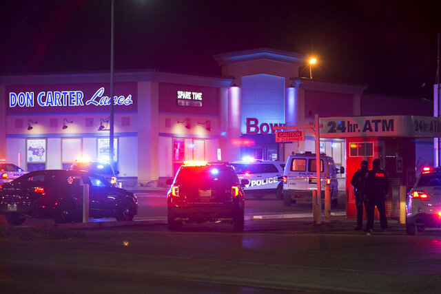 Rockford police and other law enforcement agencies investigate the scene of a shooting at bowling alley Don Carter Lanes on Saturday, Dec. 26, 2020, in Rockford, Ill. (Scott P. Yates/Rockford Register Star via AP)