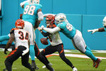 Miami Dolphins outside linebacker Shaq Lawson (90) sacks Cincinnati Bengals quarterback Brandon Allen (8) during the second half of an NFL football game, Sunday, Dec. 6, 2020, in Miami Gardens, Fla. (AP Photo/Wilfredo Lee)