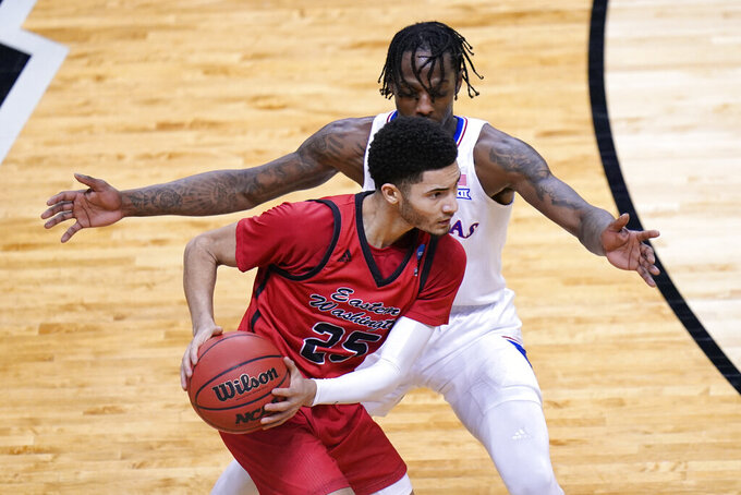 Eastern Washington guard Michael Meadows (25) looks for help as Kansas guard Marcus Garrett, presses, during the second half of a first-round game in the NCAA college basketball tournament at Farmers Coliseum in Indianapolis, Saturday, March 20, 2021. (AP Photo/AJ Mast)