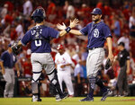 San Diego Padres relief pitcher Brad Hand, right, and catcher Raffy Lopez celebrate following a baseball game against the St. Louis Cardinals on Wednesday, June 13, 2018, in St. Louis. The Padres won 4-2. (AP Photo/Jeff Roberson)
