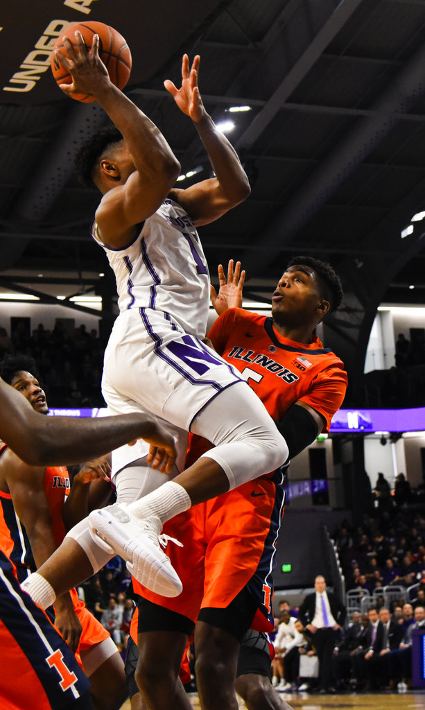 Northwestern guard Anthony Gaines (11) shoots over Illinois guard Tevian Jones, right, during the first half of an NCAA college basketball game on Sunday, Jan. 6, 2019, in Evanston, Ill. (AP Photo/Matt Marton)