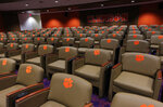 This Jan. 31, 2017 photo, shows a team meeting room inside the Clemson Football Facility at Clemson University in Clemson, S.C. When it comes to facilities in the ACC, Clemson has set the standard.  The Tigers opened a $55 million team headquarters two years ago that includes a miniature golf course, a slide and a nap room. With the team pursuing its fourth straight ACC title and College Football Playoff berth, they feel the investment is paying off. (Ken Ruinard/The Independent-Mail via AP)