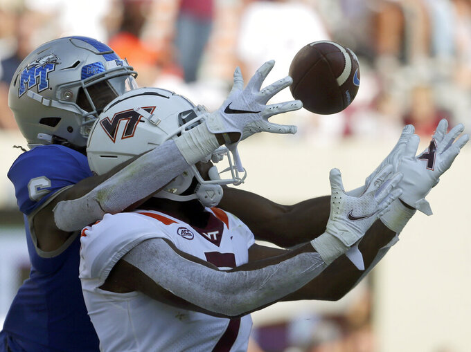 Virginia Tech defensive back Devon Hunter (7) is called for pass interference while breaking up a pass in the end zone intended for Middle Tennessee wide receiver Jimmy Marshall (6) in the second half of an NCAA college football game, Saturday, Sept. 11, 2021, in Blacksburg Va. (AP Photo/Matt Gentry)