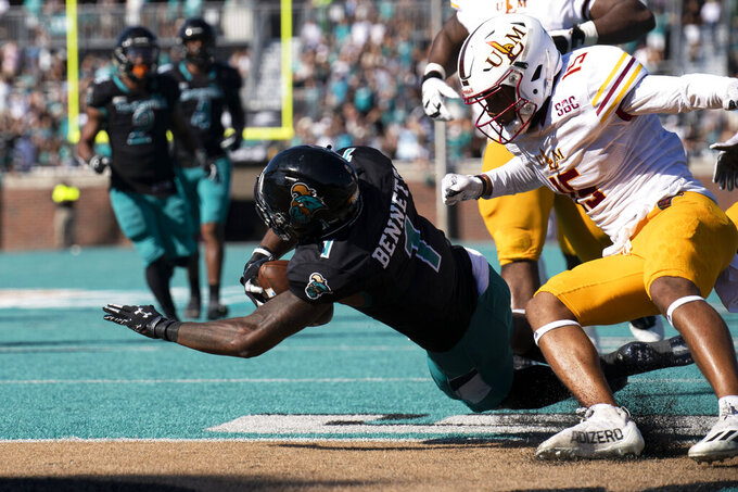 Braydon Bennett dives for a touchdown against Louisiana Monroe during the first half of an NCAA college football game on Saturday, Oct. 2, 2021, in Conway, S.C. (AP Photo/Matt Kelley)