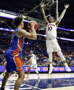 Auburn guard Samir Doughty (10) defends as Florida guard Andrew Nembhard (2) tries to pass the ball in bounds in the first half of an NCAA college basketball game at the Southeastern Conference tournament Saturday, March 16, 2019, in Nashville, Tenn. (AP Photo/Mark Humphrey)