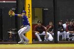 Texas Rangers' Jason Martin catch an RBI sacrifice fly off the bat of Arizona Diamondbacks' Josh Rojas during the third inning of a baseball game, Tuesday, Sept. 7, 2021, in Phoenix. (AP Photo/Matt York)