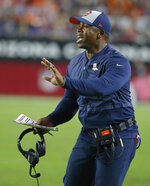 FILE - In this Oct. 18, 2018, file photo, Denver Broncos head coach Vance Joseph gestures during an NFL football game against the Arizona Cardinals, in Glendale, Ariz. Former Denver Broncos head coach Vance Joseph has been hired as the defensive coordinator on new Arizona Cardinals coach Kliff Kingsbury's staff. (AP Photo/Rick Scuteri, File)