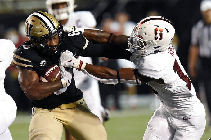 Stanford cornerback Kyu Blu Kelly, right,brings down Vanderbilt running back Re'Mahn Davis (6) in the first half of an NCAA college football game Saturday, Sept. 18, 2021, in Nashville, Tenn. (AP Photo/Mark Zaleski)