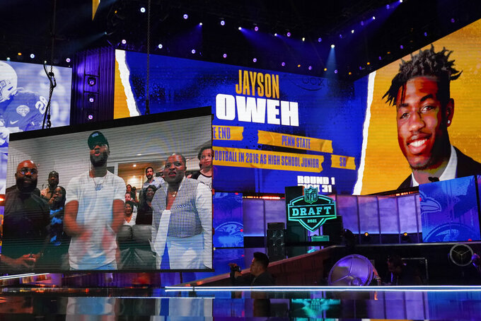 Images of Penn State defensive lineman Jayson Oweh are displayed after he was chosen by the Baltimore Ravens with the 31st pick in the first round of the NFL football draft, Thursday April 29, 2021, in Cleveland. (AP Photo/Tony Dejak)