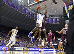 LSU forward Naz Reid (0) dunks the ball in front of Texas A&M forward Christian Mekowulu (21) as LSU forward Kavell Bigby-Williams (11), Texas A&M forward Savion Flagg (1) and Texas A&M guard Chris Collins (12) watch in the first half of an NCAA college basketball game, Tuesday, Feb. 26, 2019, in Baton Rouge, La. (AP Photo/Bill Feig)
