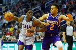 Charlotte Hornets guard Dwayne Bacon drives on Phoenix Suns forward Elie Okobo (2) during the first half of an NBA basketball game Sunday, Jan. 12, 2020, in Phoenix. (AP Photo/Rick Scuteri)