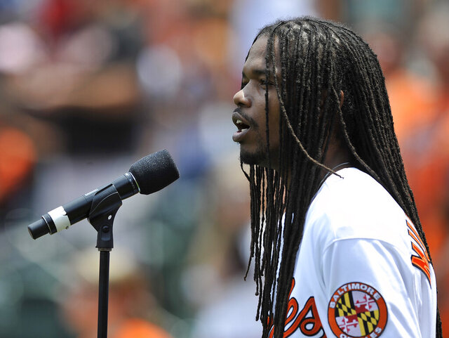 "FILE - In this June 29, 2014 file photo, Jazz singer Landau Eugene Murphy, Jr. sings the National Anthem before the Baltimore Orioles and Tampa Bay Rays baseball game, in Baltimore. The America's Got Talent"" winner put his down time during the coronavirus pandemic to good use, earning his high school equivalency diploma 30 years after dropping out.  With his road performances eliminated by the virus shutdown, the singer took online classes during the spring and summer.  (AP Photo/Gail Burton, File)"