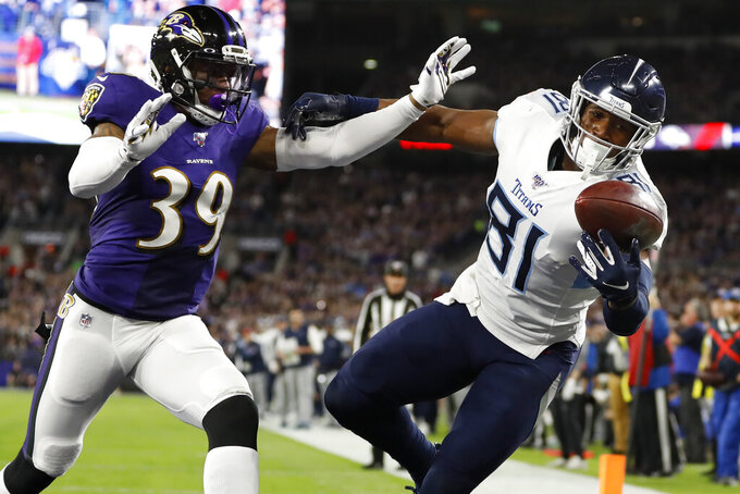 Tennessee Titans tight end Jonnu Smith (81) makes a touchdown catch against Baltimore Ravens cornerback Brandon Carr (39) during the first half an NFL divisional playoff football game, Saturday, Jan. 11, 2020, in Baltimore. (AP Photo/Julio Cortez)