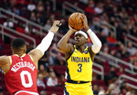 Indiana Pacers' Aaron Holiday (3) shoots as Houston Rockets' Russell Westbrook (0) defends during the first half of an NBA basketball game Friday, Nov. 15, 2019, in Houston. (AP Photo/David J. Phillip)