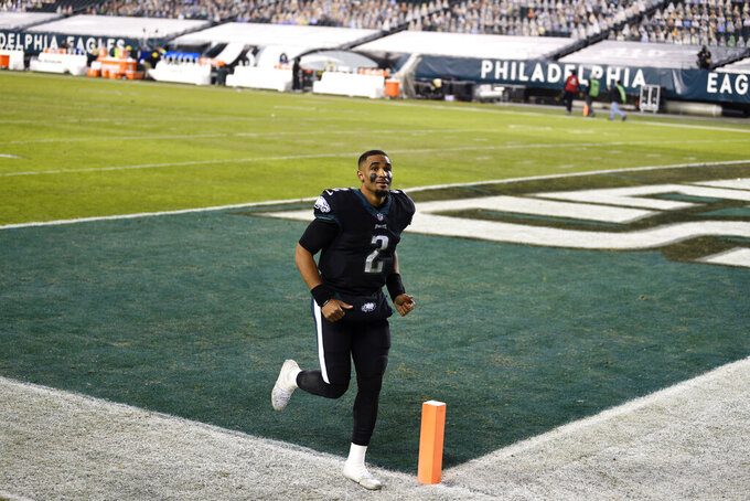 Philadelphia Eagles' Jalen Hurts runs off the field after winning an NFL football game against the New Orleans Saints, Sunday, Dec. 13, 2020, in Philadelphia. (AP Photo/Derik Hamilton)