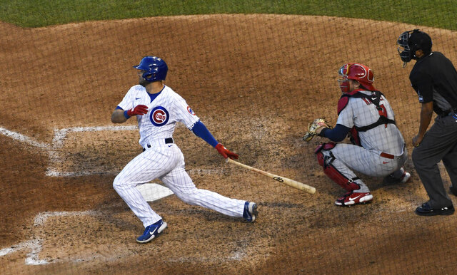 Chicago Cubs' David Bote follows through on a two-run single against the St. Louis Cardinals during the seventh inning of Game 2 of a baseball doubleheader Wednesday, Aug. 19, 2020, in Chicago. (AP Photo/David Banks)