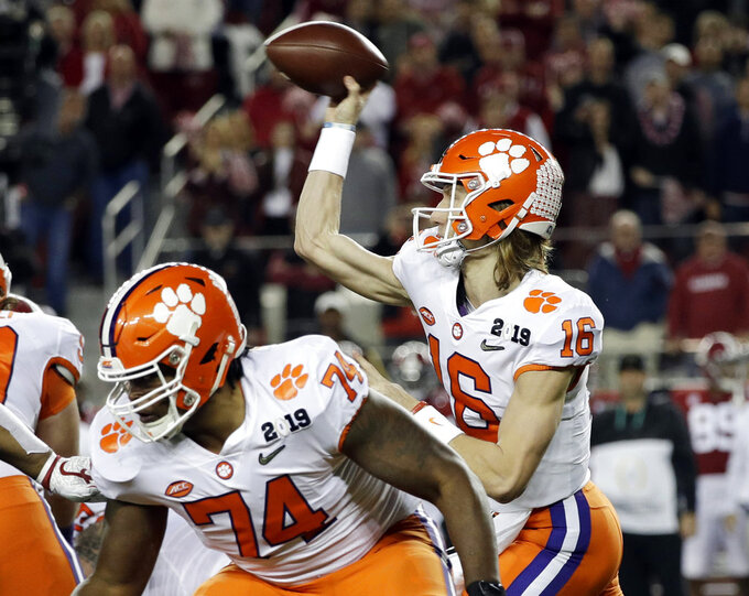 Clemson's Trevor Lawrence throws during the first half the NCAA college football playoff championship game against Alabama, Monday, Jan. 7, 2019, in Santa Clara, Calif. (AP Photo/David J. Phillip)