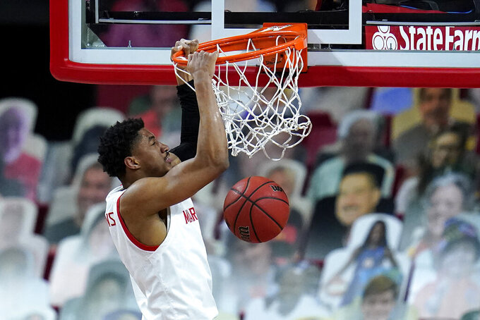 Maryland guard Aaron Wiggins dunks on Ohio State during the first half of an NCAA college basketball game, Monday, Feb. 8, 2021, in College Park, Md. (AP Photo/Julio Cortez)