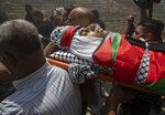 Palestinian mourners carry the body of Shaukat Awad, 20 during his funeral in the West Bank village of Beit Ummar, near Hebron, Friday, July. 30, 2021. Israeli troops shot and killed the 20 year old Palestinian man, Palestinian health officials said, during clashes that erupted in the occupied West Bank following the funeral of a Palestinian boy killed by army fire the previous day. (AP Photo/Nasser Nasser)