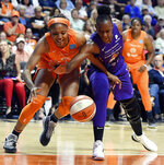 Connecticut Sun forward Kristine Anigwe, left, and Phoenix Mercury forward Sancho Lyttle reach for the ball during a WNBA basketball game Friday, July 12, 2019, in Uncasville, Conn. (Sean D. Elliot/The Day via AP)