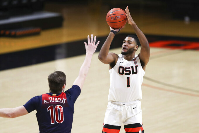 Oregon State's Maurice Calloo (1) shoots over Arizona's Azuolas Tubelis (10) during the first half of an NCAA college basketball game in Corvallis, Ore., Thursday, Jan. 14, 2021. (AP Photo/Amanda Loman)