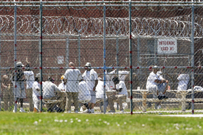 Prisoners populate a yard at the Nebraska State Penitentiary in Lincoln, Neb., Thursday, June 25, 2020. Five years after Nebraska lawmakers approved a sweeping plan to reduce prison crowding, state officials are only marginally closer to fixing the problem despite millions of dollars in additional funding. Nebraska is virtually certain to fall into an