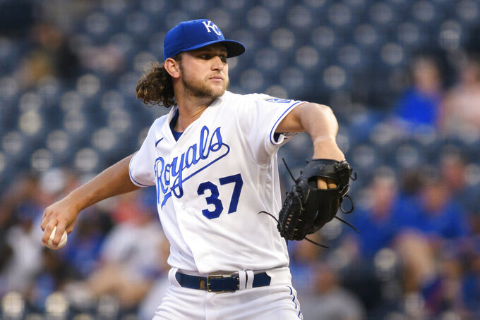 Kansas City Royals starting pitcher Jackson Kowar throws during the first inning of a baseball game against the Oakland Athletics, Tuesday, Sept. 14, 2021 in Kansas City, Mo. (AP Photo/Reed Hoffmann)