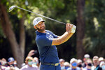 Dustin Johnson watches his drive down the ninth fairway during the final round of the RBC Heritage golf tournament in Hilton Head Island, S.C., Sunday, April 18, 2021. (AP Photo/Stephen B. Morton)