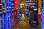Louis Dearani, Jr. helps to clean up after his family business, United Automatic Fire Sprinkler, was flooded from the remnants of Hurricane Ida that hit the area, in Woodland Park, N.J., Thursday, Sept. 2, 2021. (AP Photo/Seth Wenig)