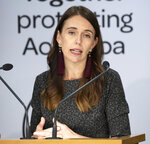 New Zealand's Prime Minister Jacinda Ardern on Tuesday, April 6, 2021, in Wellington, New Zealand, announces conditions for quarantine-free travel with Australia. The start of quarantine-free travel between the neighboring nations comes as a relief to families who have been separated by the coronavirus pandemic as well as to struggling tourist operators. (Mark Mitchell/New Zealand Herald via AP)