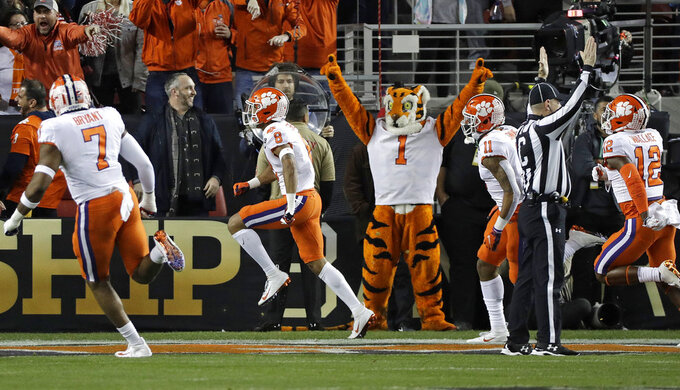 Clemson's A.J. Terrell reacts after intercepting a pass and returning it for a touchdown during the first half the NCAA college football playoff championship game, against Alabama, Monday, Jan. 7, 2019, in Santa Clara, Calif. (AP Photo/David J. Phillip)