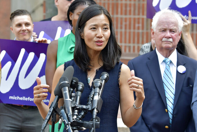 Mayoral Candidate City Councilor Michelle Wu speaks to reporters outside City Hall in Boston on Wednesday, Sept. 15, 2021. Wu placed first in a preliminary mayoral election that selected two top contenders from a field of five candidates all of whom are people of color, four of them women. (AP Photo/Josh Reynolds)