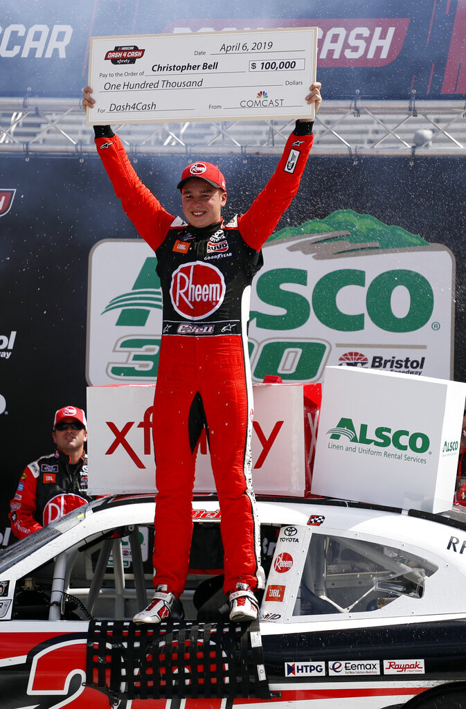 Driver Christopher Bell celebrates in Victory Lane after winning the NASCAR Xfinity Series auto race on Saturday, April 6, 2019, in Bristol, Tenn. (AP Photo/Wade Payne)