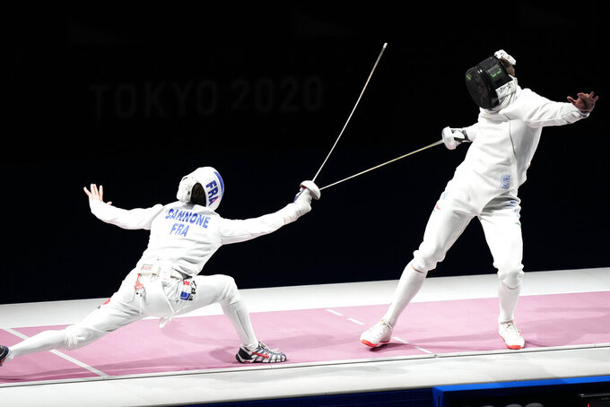 Romain Cannone of France, left, and Gergely Siklosi of Hungary compete in the men's individual final Epee competition at the 2020 Summer Olympics, Sunday, July 25, 2021, in Chiba, Japan. (AP Photo/Andrew Medichini)
