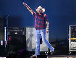 "FILE - In this Sept. 21, 2018 file photo, Jason Aldean performs at the 2018 iHeartRadio Music Festival in Las Vegas. Aldean's ""Drowns the Whiskey"" featuring Miranda Lambert is nominated for single of the year and song of the year for the Country Music Association Awards. (Photo by John Salangsang/Invision/AP, File)"