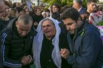 Mourners cry during a funeral of an earthquake victim in Thumane, western Albania, Friday, Nov. 29, 2019. The operation to find survivors and recover bodies from Albania's deadly earthquake was winding down Friday as the death toll climbed to 49. (AP Photo/Visar Kryeziu)