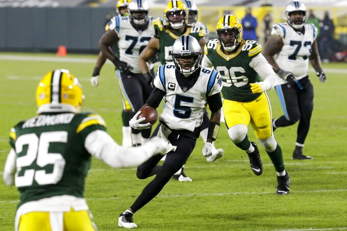 Carolina Panthers' Teddy Bridgewater runs for a touchdown during the second half of an NFL football game against the Green Bay Packers Saturday, Dec. 19, 2020, in Green Bay, Wis. (AP Photo/Mike Roemer)