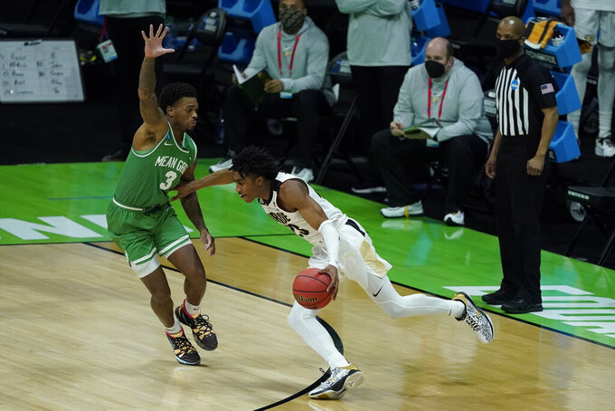 Purdue's Jaden Ivey (23) goes to the basket against North Texas's Javion Hamlet (3) during the second half of a first-round game in the NCAA men's college basketball tournament at Lucas Oil Stadium, Friday, March 19, 2021, in Indianapolis. (AP Photo/Darron Cummings)
