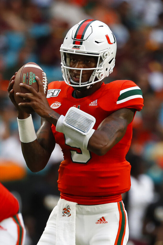 Miami quarterback N'Kosi Perry takes a snap during the second half of an NCAA college football game against Bethune-Cookman, Saturday, Sept. 14, 2019, in Miami Gardens, Fla. Miami defeated Bethune Cookman 63-0. (AP Photo/Wilfredo Lee)