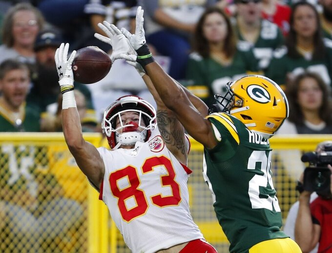 Green Bay Packers' Ka'Dar Hollman breaks up a pass intended for Kansas City Chiefs' Cody Thompson during the first half of a preseason NFL football game Thursday, Aug. 29, 2019, in Green Bay, Wis. (AP Photo/Matt Ludtke)