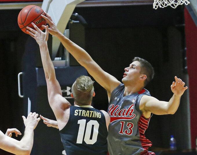 Utah forward Novak Topalovic (13) blocks the shot of Colorado forward Alexander Strating (10) during the second half of an NCAA college basketball game Sunday, Jan. 20, 2019, in Salt lake City. (AP Photo/Rick Bowmer)