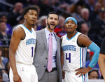 Charlotte Hornets coach James Borrego talks with guards Malik Monk, left, and Devonte' Graham during the first quarter of the team's NBA basketball game against the Sacramento Kings in Sacramento, Calif., Wednesday, Oct. 30, 2019. (AP Photo/Rich Pedroncelli)