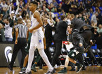 Duke forward Javin DeLaurier (12) walks past Michigan State bench who begin celebrating their win at the end of the NCAA men's East Regional final college basketball game in Washington, Sunday, March 31, 2019. (AP Photo/Alex Brandon)