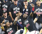 Atlanta Braves' Marcell Ozuna, front, pretends to take a selfie as he celebrates with teammates after they defeated the Miami Marlins in Game 3 of a baseball National League Division Series, Thursday, Oct. 8, 2020, in Houston.(Curtis Compton/Atlanta Journal-Constitution via AP)