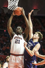 Illinois' Kofi Cockburn (21) goes to the basket as Northwestern's Ryan Young (15) defends in the first half of an NCAA college basketball game, Saturday Jan. 18, 2020, in Champaign, Ill. (AP Photo/Holly Hart)