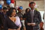 This image released by Netflix shows Niecy Nash, left, and Mamoudou Athie in a scene from