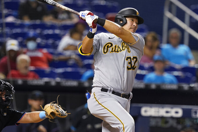 Pittsburgh Pirates' Yoshi Tsutsugo watches a single during the ninth inning of the team's baseball game against the Miami Marlins, Saturday, Sept. 18, 2021, in Miami. The Pirates won 6-3. (AP Photo/Marta Lavandier)
