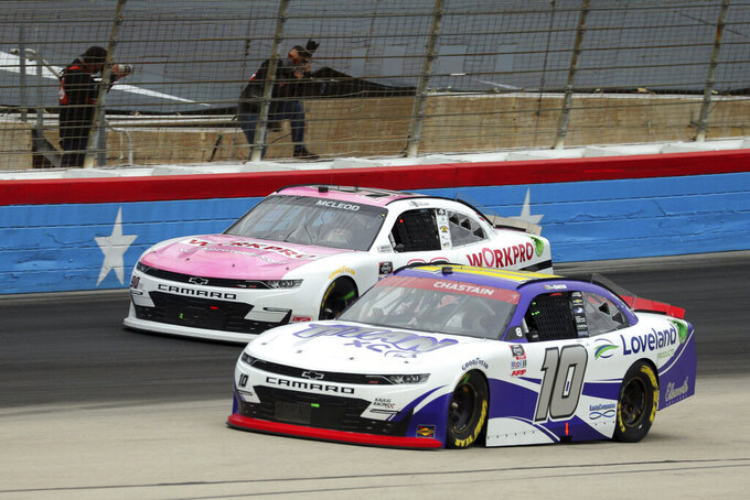 NASCAR Xfinity Series driver B.J. McLeod (90) and driver Ross Chastain (10) come out of turn four onto the front stretch during a NASCAR Xfinity Series auto race at Texas Motor Speedway in Fort Worth, Texas, Saturday Oct. 24, 2020. (AP Photo/Richard W. Rodriguez)