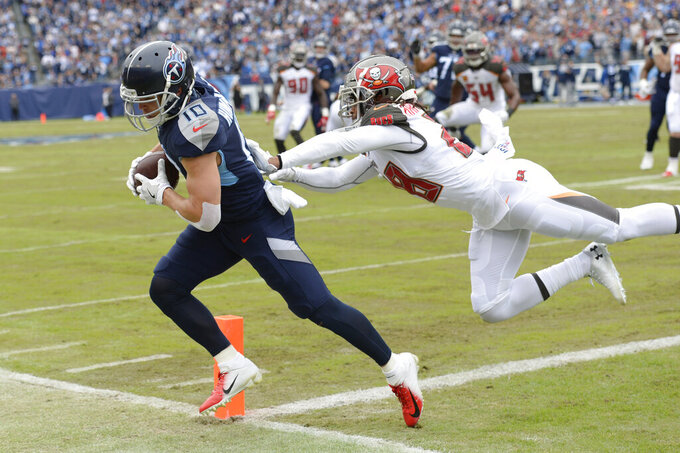 Tennessee Titans wide receiver Adam Humphries (10) is pushed out of the end zone by Tampa Bay Buccaneers cornerback Vernon III Hargreaves (28) in the first half of an NFL football game Sunday, Oct. 27, 2019, in Nashville, Tenn. (AP Photo/Mark Zaleski)